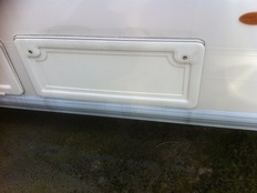 Caravan side locker doors